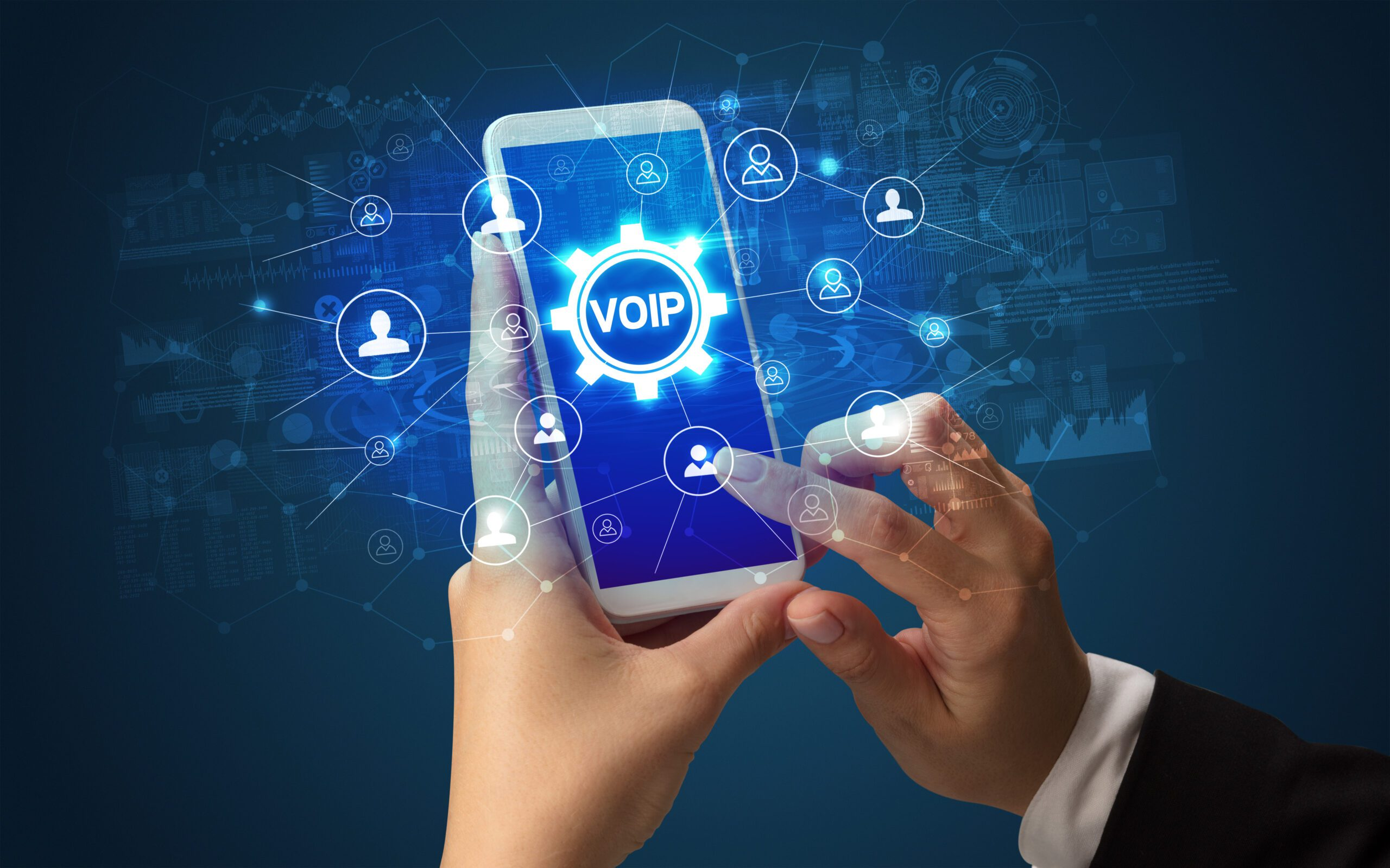 Female hand holding smartphone with VOIP abbreviation, modern technology concept